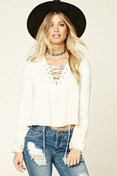 This crisp white lace up top is sexy and chic! Pair it with a cardigan and skinny jeans for an Autumn look and a body con skirt and metallic gladiator sandals for a Summer look!