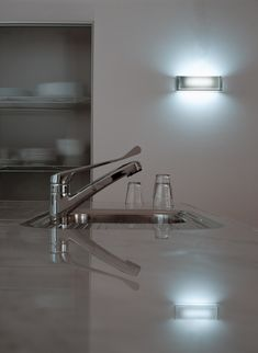 Inspired by the look and feel of an ice cube, the On the Rocks wall light is dimmable in stunning, transparent glass. Designed by Antonio Citterio and Toan Nguyen. #flos #floslighting #design #lightingdesign #italiandesign #interiorinspiration #italianlighting #interiordesign #modernlamp #contemporarylighting #lightingideas #homedecor #kitchenlighting #islandlighting #kitchendesign #flosathome #antoniocitterio #toannguyen Wall Sconce Lighting, Home Lighting, Modern Lighting, Wall Sconces, Kitchen Lighting, Cube Design, Italian Lighting, Wall Lights, Ceiling Lights