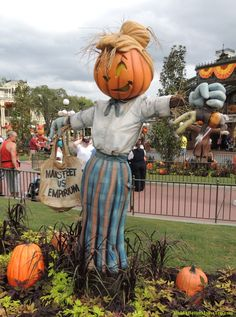Shopping scarecrow - I love the doll with the Mickey Ears in her left hand.  Fall decorations in the Magic Kingdom at Disney World.  For Disney World crowd warnings, ride closures and special event information, see: http://www.buildabettermousetrip.com/crowds-closures-special-events/