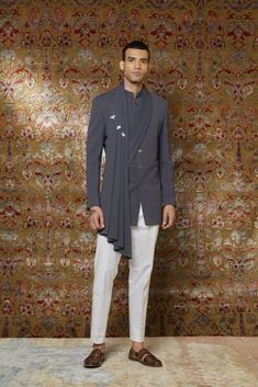 Grey draped indowestern with trouser! Get your Amazing Qbik menswear piece from, now! Contact us now 07931 999111 or email us at contact@bibilondon.com to book your Consultation, for bespoke and customized services by our experienced team! #menswear#IndianCouture #bibilondon #qbik#bibildn #indiancouture #indiansuit #qbikatbibilondon #sherwani #indiangroom Mens Indian Wear, Mens Ethnic Wear, Indian Groom Wear, Indian Men Fashion, Wedding Kurta For Men, Wedding Dress Men, Indian Wedding Outfits, Blazer Outfits Men, Kurta Men