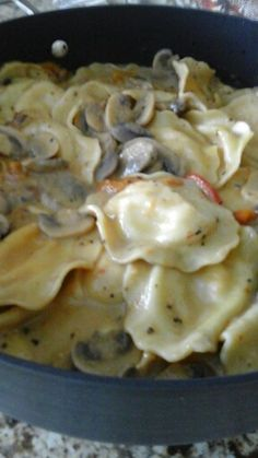 Chicken ravioli with mushrooms and peppers
