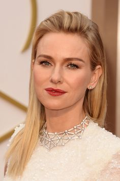 Straight strands, bold brows, and a rich crimson lip made up Naomi Watts's beauty look.