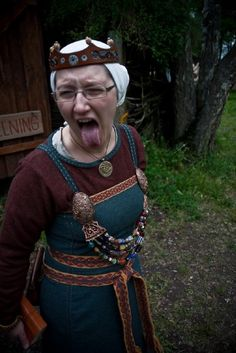 Annika Madejska. - like the coif and the simple round neckline (wool dress, too).