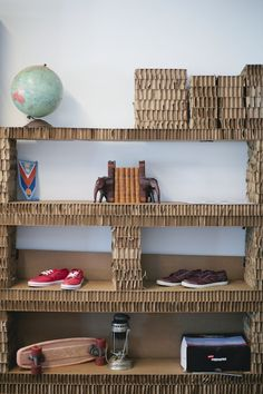upcycled cardboard shelving at @The Peoples Movement