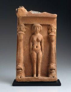 The plaque is a mixture of Mediterranean/Near Eastern styles that characterize Phoenician art. It represents the ancient Canaanite goddess Astarte, shown nude like the Mesopotamian Ishtar, but with an Egyptian face and wig. She stands within a shrine protected by typically Near Eastern snarling lions that support Egyptian columns surmounted by heads of the Egyptian god Bes.
