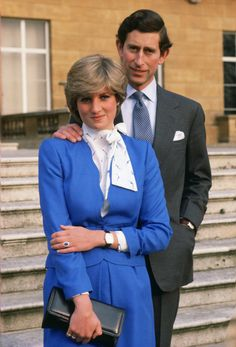 GREAT BRITAIN - FEBRUARY 24: Lady Diana Spencer (later to become Princess of Wales) reveals her sapphire and diamond engagement ring while she and Prince Charles, Prince of Wales pose for photographs in the grounds of Buckingham Palace following the announcement of their engagement