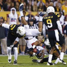 Nov. 30 - ASU denfensive end Damarious Randall, left, knocks Arizona wide receiver Trey Griffey on his head in the first quarter during the ...