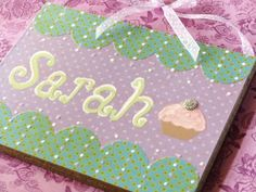 scrapbook paper, mod podge, and name plaques