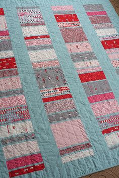 Coin Quilt with link to tutorial. I like the tiny strips of turquoise in the pieced strip.