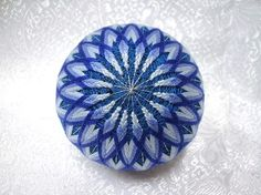 Japanese Temari Christmas Ornament : Having begun in China and then introduced to Japan 500 to 600 years ago, temari is the ancient art of embroidering thread balls. Temari balls began as children's toys but evolved into an art form as the silk stitching and designs became more intricate. With the introduction of cotton threads, temari was no longer exclusive to the aristocracy and the art of temari flourished. These treasured items are often given as gifts on special occasions and holidays…