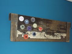 Old storm door saved from the garbage and reused as wall art - added reverse glass flowers painted ashtrays -also a find ...Warhol inspired .