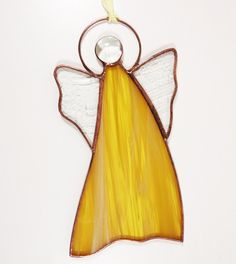 Stained Glass Suncatcher Angel 6 inch tall, amber and white color glass, copper color metal, handmade Stained Glass Angel, Stained Glass Ornaments, Stained Glass Suncatchers, Amber Color, Copper Color, How To Make Ornaments, Holiday Ornaments, Colored Glass, Glass Art