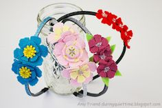 Tattered Floral Headbands from felt featuring the @Tim Harbour Holtz Tattered Floral Die.  Project by @Amy Lyons Friend.