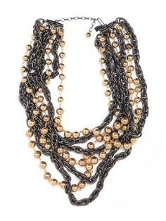 Tired of the old ball and chain? Then try this stylish, cool necklace—it features an alluring tangle of hematite chain links mixed with strands of gold beads.