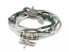 The Dragonfly is a leather wrap charm bracelet that can also be worn as a necklace. The dragonfly charm is symbolic of transformation, lightness and joy. Handcr