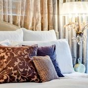 Chandelier as bedside lighting.  Pallos Verdas Drive - Staged to DWELL