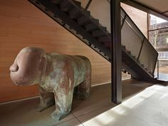 Image 24 of 36 from gallery of Whistler Ski House / Olson Kundig. Photograph by Benjamin Benschneider Concrete Fireplace, Fireplace Hearth, Concrete Floors, Whistler, Jackson Hole Skiing, Ski Rental, Glazed Walls, Stair Railing, Stairs