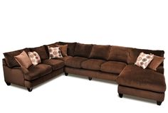 Curl into the comfort of this vast sectional, and discover the cozy combination of cocoa brown and corduroy.
