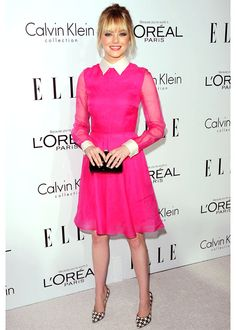 Emma Stone was pretty in pink Valentino for Elle's Women in Hollywood Celebration. In a vibrant bubble-gum chiffon collared confection, Emma hit a home run again! Ferragamo houndstooth pumps were an unconventional graphic touch that elevated the whole look.