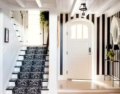 bold black and white entry.  zebra runner + vertical stripes in sherwin williams black jack & decorators white