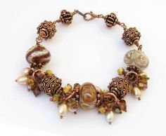 Beaded Glass Brown and Ivory Lampwork Pearls and Copper Bracelet  I wish this was a necklace. I love Brown!