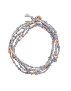 double wrap bracelet blue rose gold handmade in Guatemala and sold by the little market -- The Little Market works with artisan groups around the world. The work of each of their groups is funded through earnings from the sales of their fair trade and locally made products.