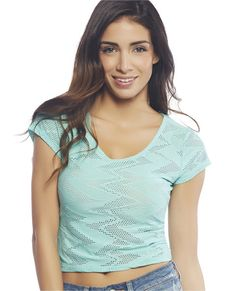"Layer it on whether it is over your bathing suit, a bandeau, or a cami, this cropped tee is for you!  It features a stretchy knit body with a solid zig zag pattern with in between mesh, scoop neck, and short sleeves.  Model is 5'9"" and wears a size small   	94% Polyester / 6% Spandex 	Machine Wash 	USA"
