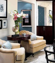 I love DIvine Design and Candice Olson. I wish I could find a better pic of this amazing living room. She picked great light fixtures for this one!