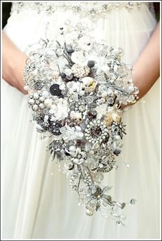 Love, love, love this bouquet.....antique broaches, jewelry, buttons....  :)