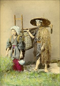 https://flic.kr/p/7ADxzi | Japanese Farmers | A staged 19th century photograph of a farmer and his wife. The man wears the traditional straw rain coat ( 蓑, mino) and kasa (笠), a hat made of bamboo or sedge. Unidentified photographer. Note that there is a small number close to the left foot of the farmer. It is blotted out, but still visible. Maybe an early pirated view? Although this is only a small sized albumen print, the coloring is very precise. (Photographer probably Kusakabe Kimbei)