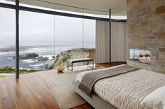 Now this is a view I would love to wake up to every morning. Love the stone wall and fireplace too.