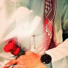 Muslim boy wearing black watch and holding a rose Muslim Photos, Muslim Images, Wedding Couple Poses Photography, Boy Photography Poses, Arab Fashion, African Men Fashion, Boy Fashion, Stylish Dpz, Stylish Boys