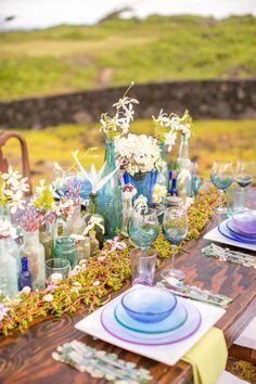 Succulents, moss, bottles. Floral Design: Jessica Keay. Photography: Kaua Wedding Photography - kauaweddingphotography.com/  Read More: http://www.stylemepretty.com/destination-weddings/2014/06/30/romantic-hawaiian-inspiration/
