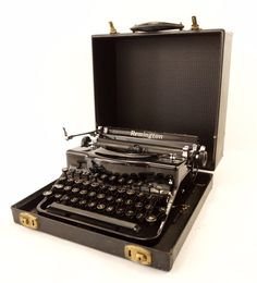 Add this Remington Rand Model 1 typewriter from the 1930s to your collection! This typewriter was made in the 1930s, serial number PD176000. It includes the original case. Add this collectible antique
