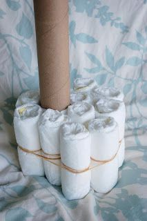 A diaper cake is a great homemade baby shower gift that doubles as a baby shower decoration. This diaper cake was for my friend's baby g...