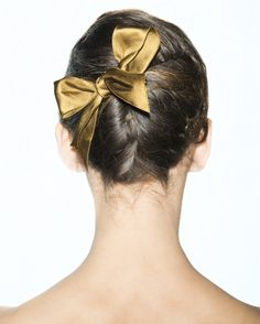 Find 9 gorgeous new ways to wear a top knot, now on wmag.com.