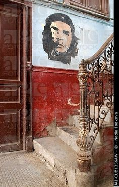 Che Guevara mural in the old building/ entrance to LA GUARIDA restaurant, Havana, Cuba, Caribbean.