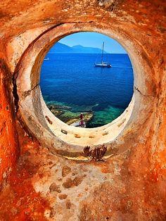 Beautiful Doorways !! Part 2 -  Window to the Ionian Sea. Venetian lighthouse close to Fiskardo.