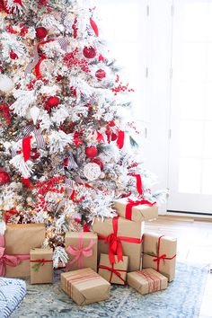 Gorgeous white and red Christmas tree with paper wrapped presents | Pink Peonies