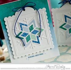 handmade quilt block ... snowflake die cut ... luv the cool colors of the tiny print papars used in the fill ...