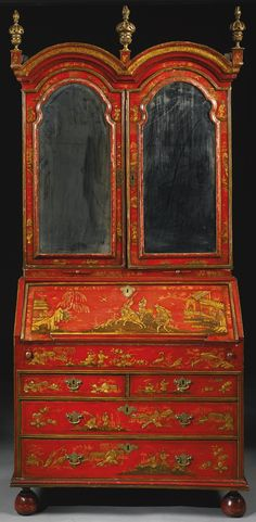 A GEORGE I PARCEL-GILT SCARLET JAPANNED DESK-AND-BOOKCASE IN THE MANNER OF JOHN BELCHIER CIRCA 1720