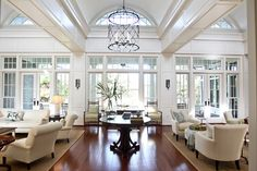 Captivating Birdcage Chandelier Spreads Antique Nuance to Your Residence: Good Looking White Decor Of Traditional Living Room Using Birdcage Chandelier In The Middle Above Modular Wooden Table ~ BESS Chandelier Inspiration