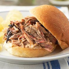 Prep these slow cooker pulled pork sliders when you're serving a crowd--or plan to feed for family through a day of tailgating or potluck dining. This sweet and tangy slow cooker slider recipe makes 20 servings! Pulled Pork Shoulder, Pork Shoulder Roast, Cooking For A Crowd, Food For A Crowd, Slow Cooker Recipes, Cooking Recipes, Bhg Recipes, Pan Cooking, Freezer Recipes