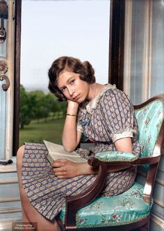 Princess Elizabeth reading at Windsor castle, 1940, nearly a year into WWII.