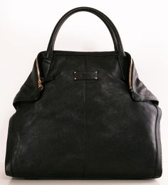 This is a beautiful Alexander McQueen black classic handbag with timeless details.