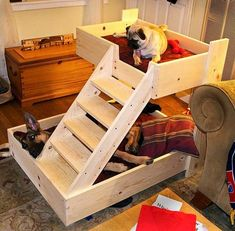 Look at this amazing pallet wood bunk bed for both of your lovely doggys. The design is simple yet elegant. Thee beds are lined up with comfy mattress. Make sure that the stairs for upper bed are good and comfortable for your pup to use. The lower bed is bigger to cater to your big doggy's needs.