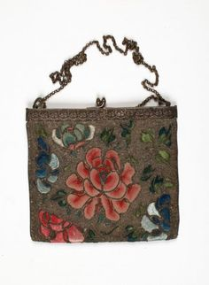The peony in the centre is embroidered with Chinese knot stitch on one side of the bag, and satin stitch on the other. This design of a straight frame and chain handle was very popular during the 1920s.