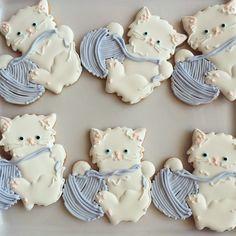 white kitty playing w/ ball of yarn