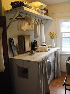 Rustic Farmhouse - I really love the idea of having a folding table on top of the washer/dryer!