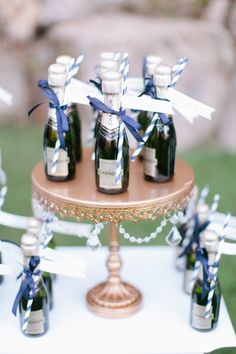 Mini champagne and straws: http://www.stylemepretty.com/vault/search/images/Favors